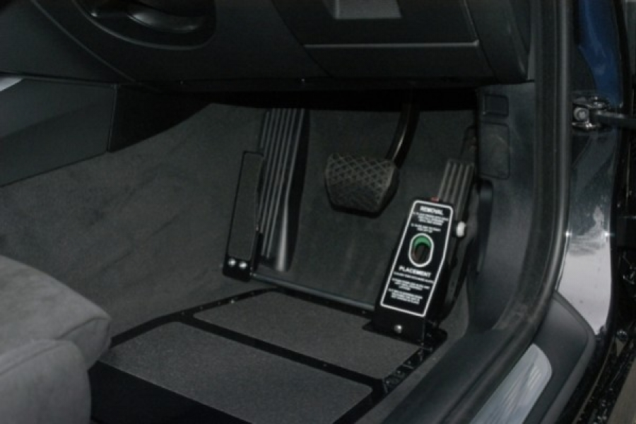 The left foot pedal and guard can be easily removed so that the vehicle can be driven conventionally. Floor Mounted Left Foot Accelerator